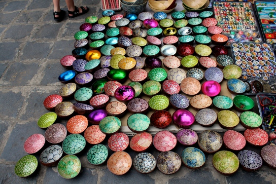 Colorful bowls made from coconut shells.